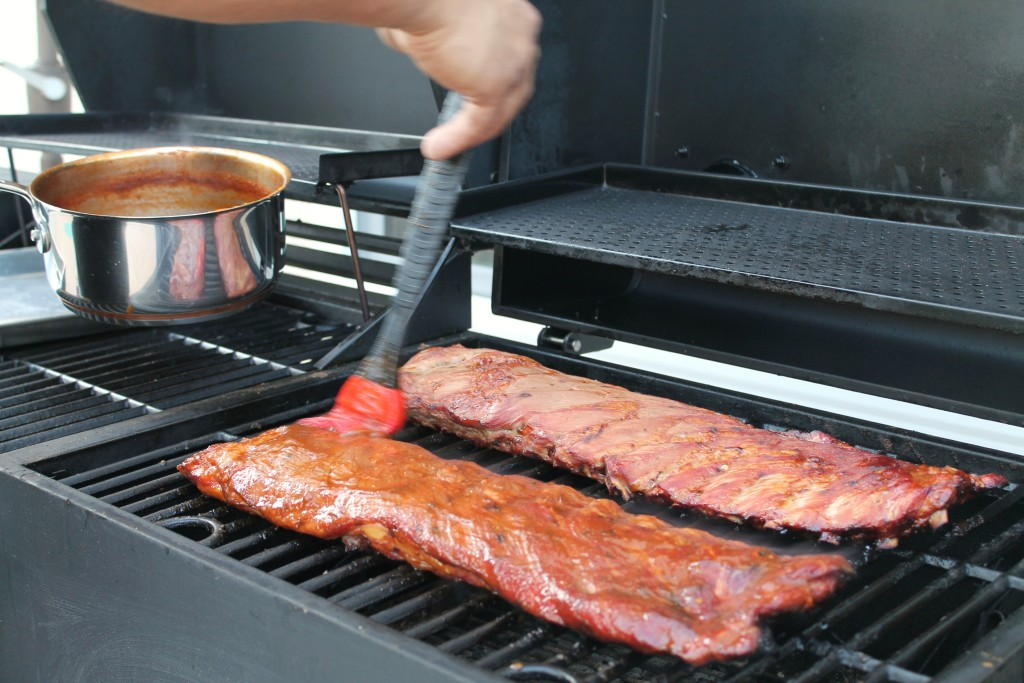 Homemade barbecue sauce on smoked ribs 6